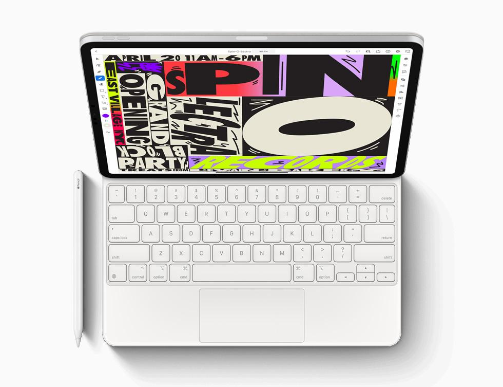 新款 iPad Pro 搭配妙控键盘和 Apple Pencil。