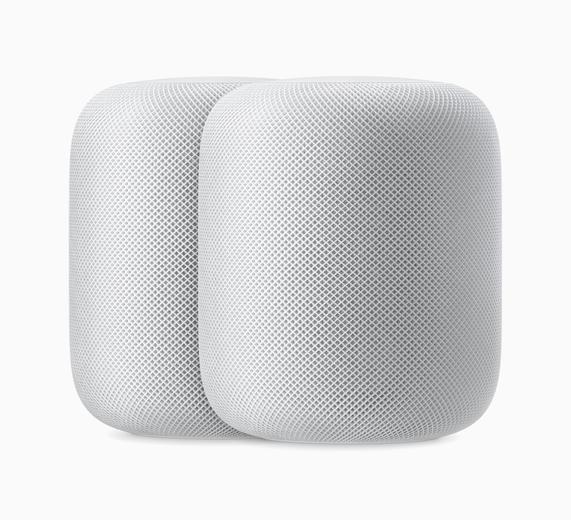 图片显示两个白色 HomePod。