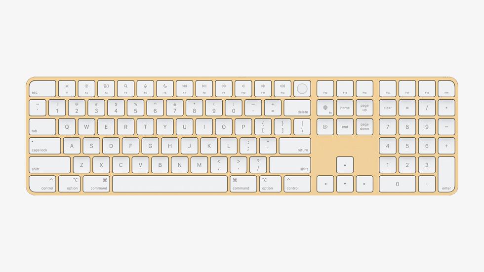 带有触控 ID 与数字小键盘的黄色妙控键盘。
