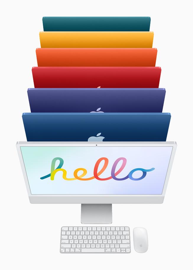 银色 iMac 与相同颜色的妙控键盘与妙控鼠标,后面是 6 种颜色的 iMac。