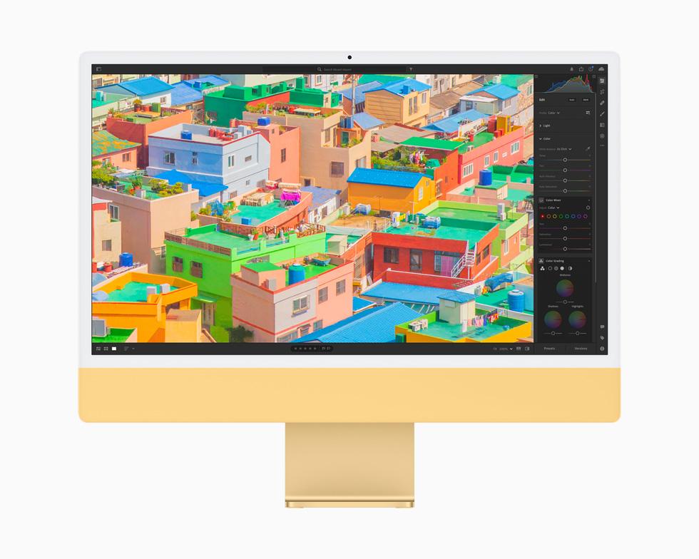 在一台黄色的 iMac 上,照片 app 正在编辑照片。
