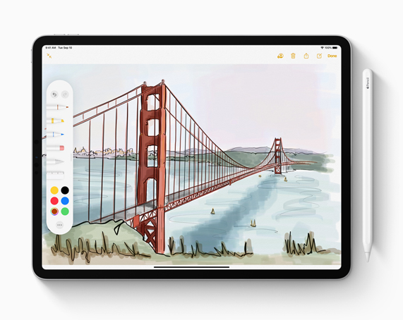 iPad 与 Apple Pencil。