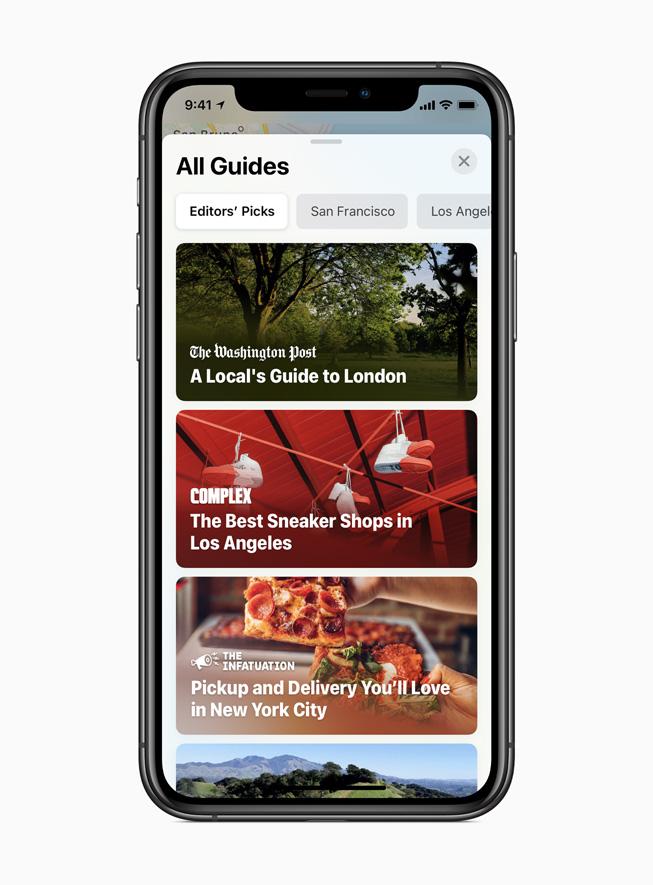 """iPhone 11 Pro 上显示地图 app 中新的""""指南""""功能。"""