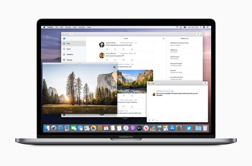 打开了数个 app 窗口的 MacBook Pro。
