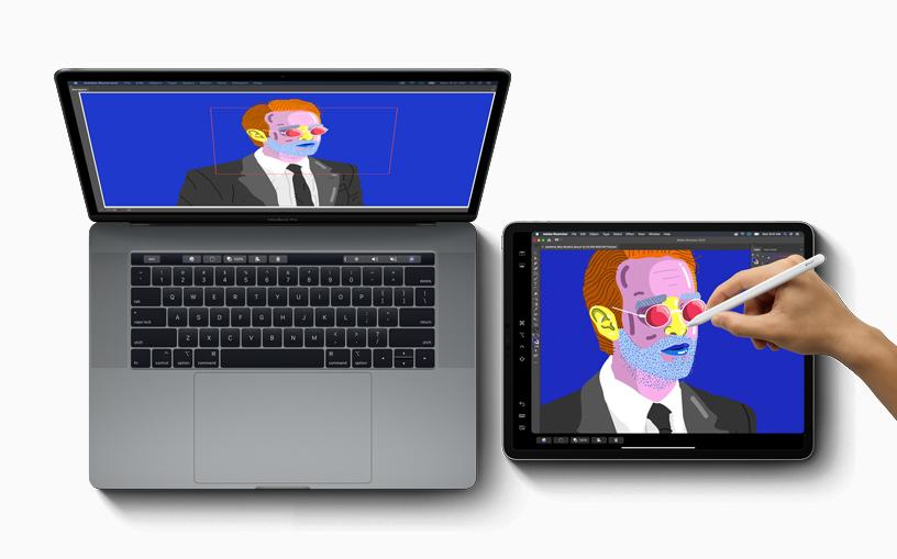 MacBook Pro 正利用 Sidecar 功能,将屏幕显示延伸至 iPad 和 Apple Pencil。