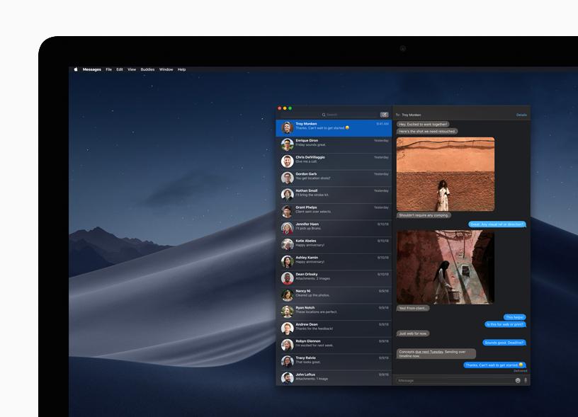 Mac 桌面上深色模式下的信息 app。