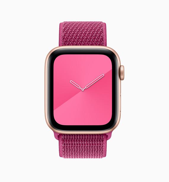 Apple Watch 粉红色回环形表带与表盘。