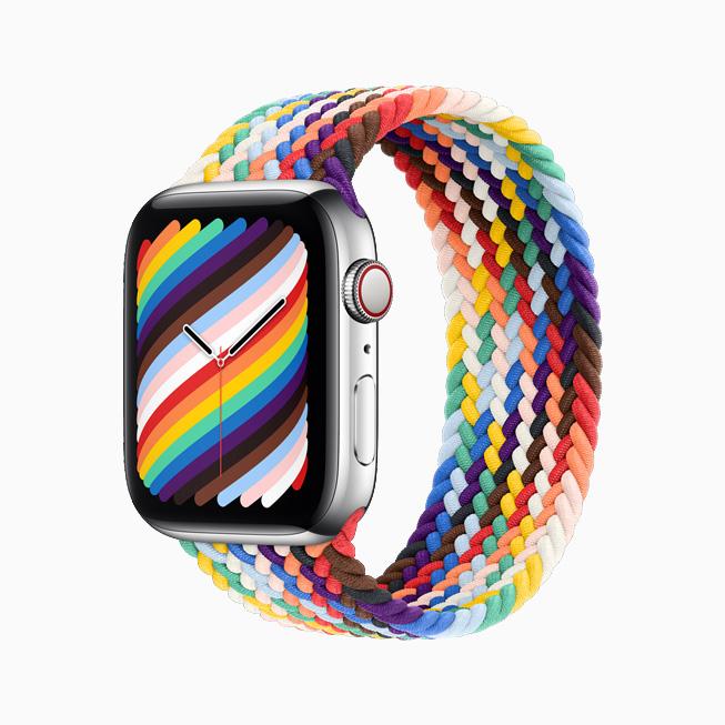 Apple Watch 彩虹版编织单圈表带和彩虹版表盘的侧视图。